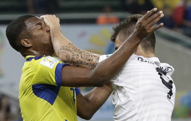 France's Olivier Giroud, right, clashes with Ecuador's Frickson Erazo, left, during the Group E World Cup match between Ecuador and France.