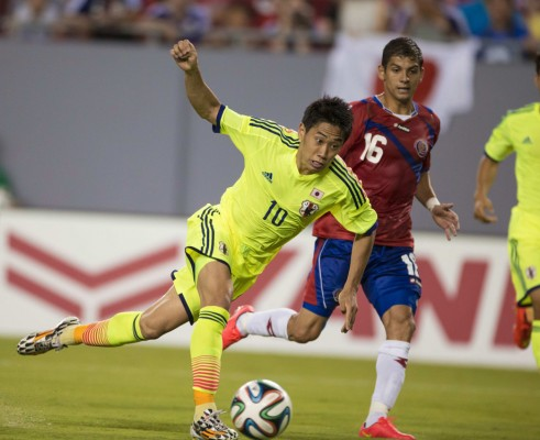 Kagawa of Japan's national soccer team, the Samurai Blue, takes a shot on goal to score past Costa Rica's Gamboa during a friendly soccer match ahead of World Cup, in Tampa