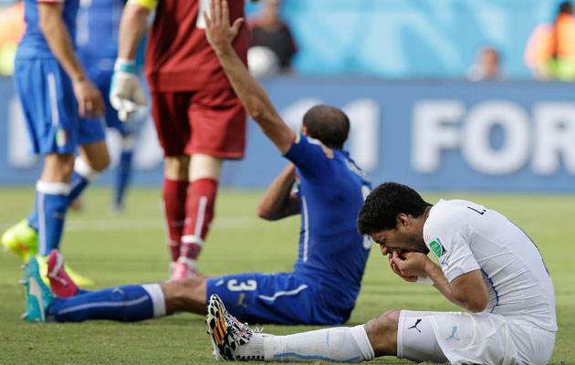 Luis Suarez doing what he does best...feeling sorry for himself