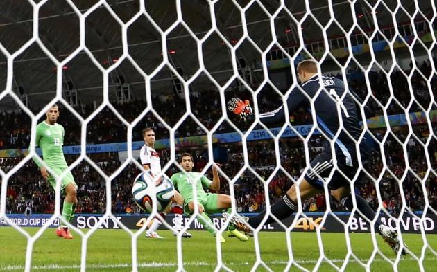 Algeria's Abdelmoumene Djabou scores past Germany's goalkeeper Manuel Neuer during their 2014 World Cup round of 16 game at the Beira Rio stadium