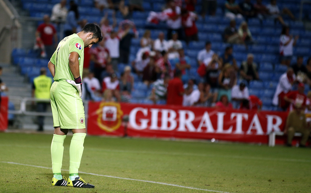 Gibraltar's goalkeeper Jordan Perez after a Poland scored during their Euro 2016 qualifier.
