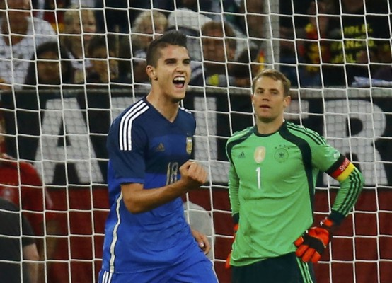 Argentina's Lamela celebrates after scoring a goal against Germany's goalkeeper Neuer during their friendly soccer match in Duesseldorf