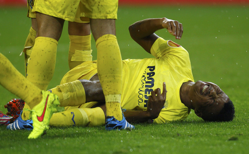 Villareal's Uche lies on ground injured after scoring goal against Borussia Moenchengladbach during Europa League soccer match in Muenchengladbach