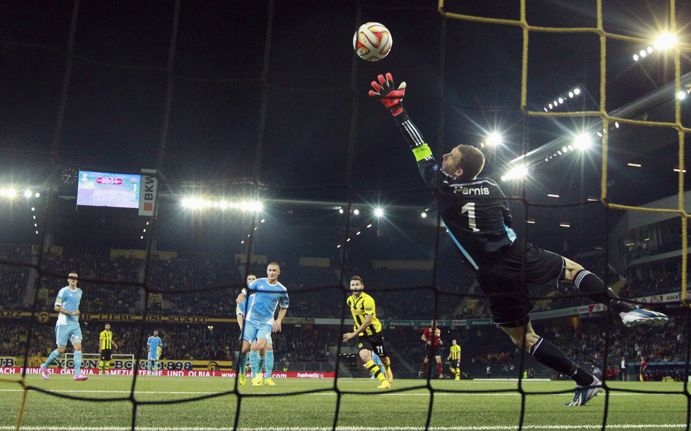 BSC Young Boys' Steffen scores a goal against Slovan Bratislava's goalkeeper Pernis during their Europa League Group I soccer match at the Stade de Suisse in Bern