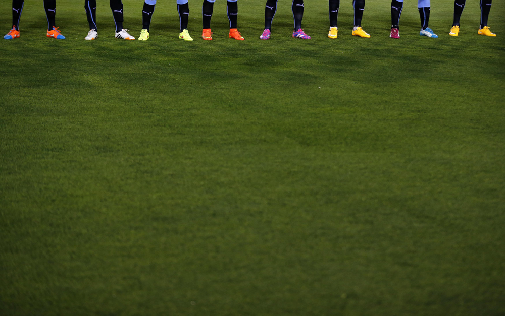 The colourful boots of the Uruguay players as they line-up before their friendly soccer match against Chile in Santiago