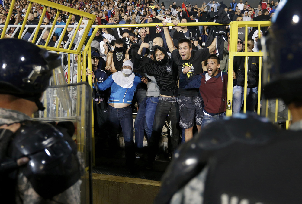Fans of Serbia confront the riot police during the Euro 2016 Group I qualifying match against Albania in Belgrade.