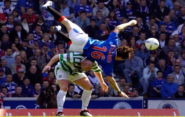 Rangers' Sotirios Kyrgiakos (top) tussles with Celtic's John Hartson