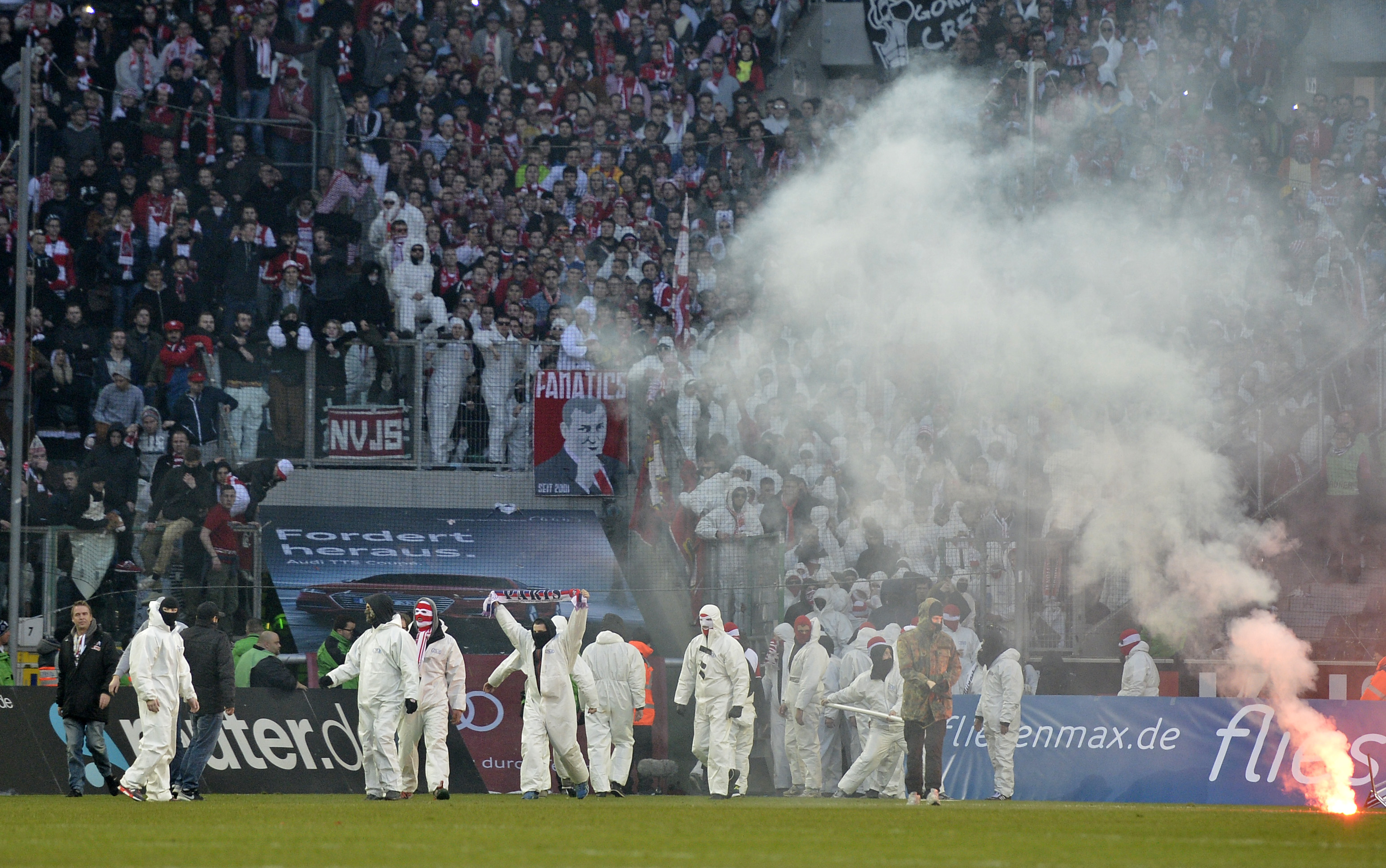 Cologne fans storm the pitch after the German Bundesliga soccer match between Borussia Moenchengladbach