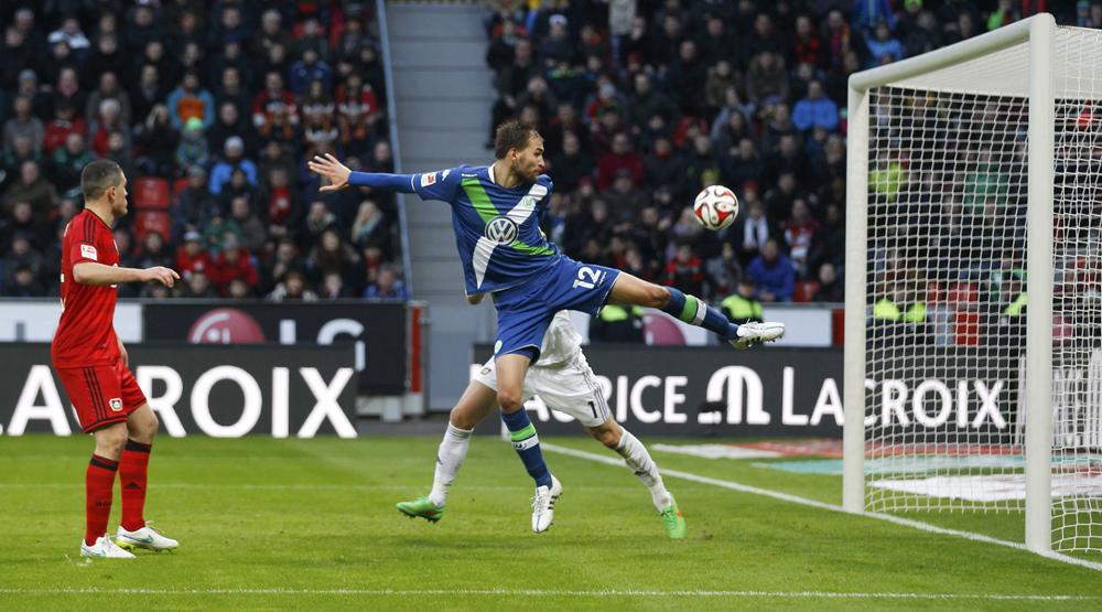 Wolfsburg's Bas Dost scores his fourth goal during their Bundesliga first division soccer match against Bayer Leverkusen in Leverkusen