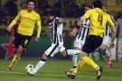 Juventus' Carlos Tevez shoots to score his side's third goal during the Champions League round of 16 second leg match between Borussia Dortmund and Juventus.