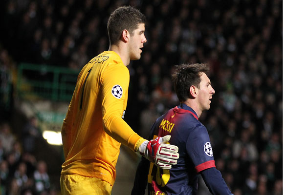 Lionel Messi gets a consoling pat on the back from Celtic goalkeeper Fraser Forster.