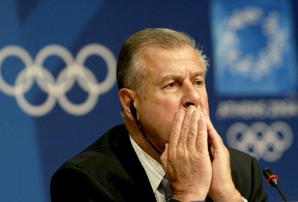IOC official Carrard listens to a questions during news conference in Athens.