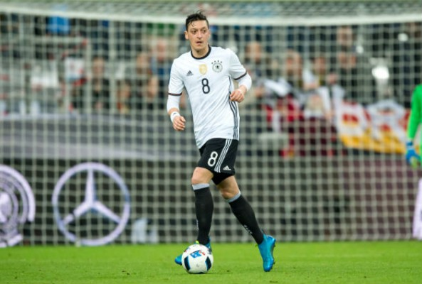Mesut Ozil reflects on his time in England and previews Euro 2016 saying that France are one of the principal contenders