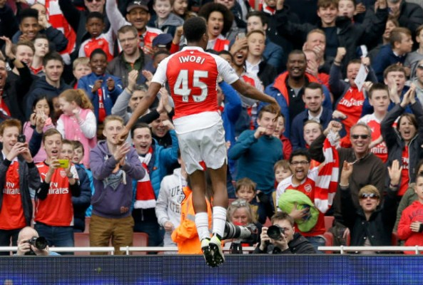 Wenger's record on promoting youth is poor. Alex Iwobi celebrates scoring against Watford