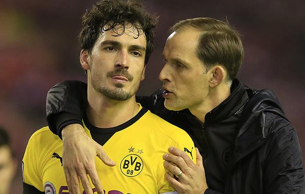 Dortmund's coach Thomas Tuchel comforts Mats Hummels after the defeat to Liverpool.