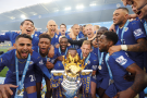 ENGLAND…Leicester City captain Wes Morgan and team-mates prepare to lift the Premier League trophy after their final home game of the season