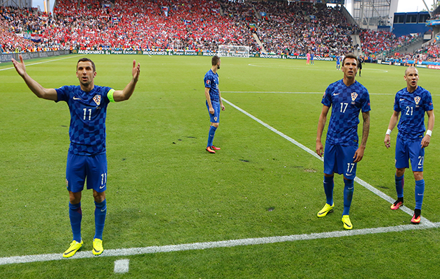 Croatia players appeal for calm amongst their supporters.