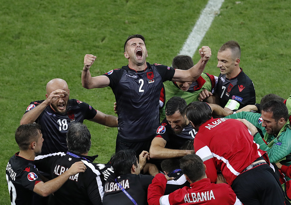 Albania's Andi Lila shouts raising his arms while celebrating his team's opening goal during the Euro 2016 Group A match against Romania in Lyon.