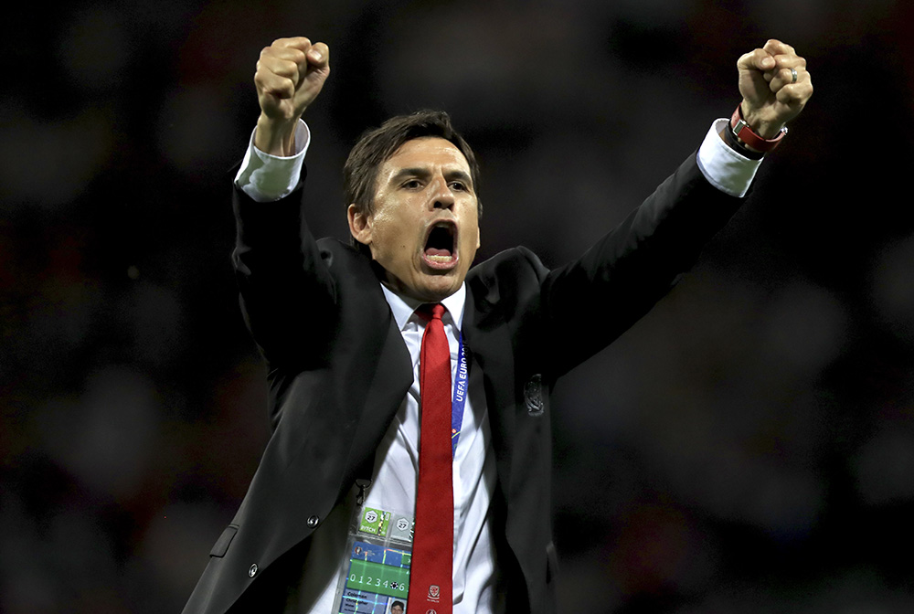 Wales manager Chris Coleman celebrates victory after the final whistle during the UEFA Euro 2016, Group B match at Stadium Municipal, Toulouse.