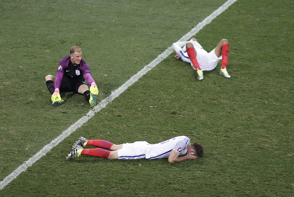Goalkeeper Joe Hart and two others player lie on the pitch at the end of the Euro 2016 round of 16 match between England and Iceland, at the Allianz Riviera stadium in Nice.