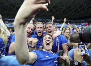 Iceland's Haukur Heidar Hauksson takes a selfie with supporters at the end of the win against England in Nice.