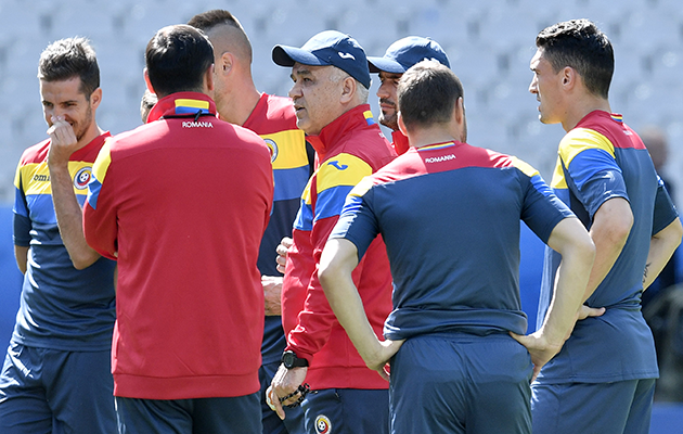 Romania coach Anghel Lordanescu, centre, leads a training session at the Stade de France