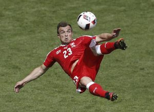 Switzerland's Xherdan Shaqiri scores on an acrobatic bicycle kick during the Euro 2016 round of 16 match against Poland, at the Geoffroy Guichard stadium in Saint-Etienne.