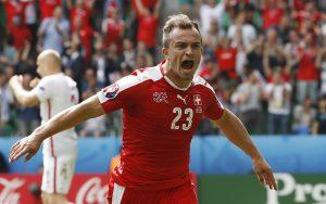 Switzerland's Xherdan Shaqiri celebrates after scoring their first goal against Poland.