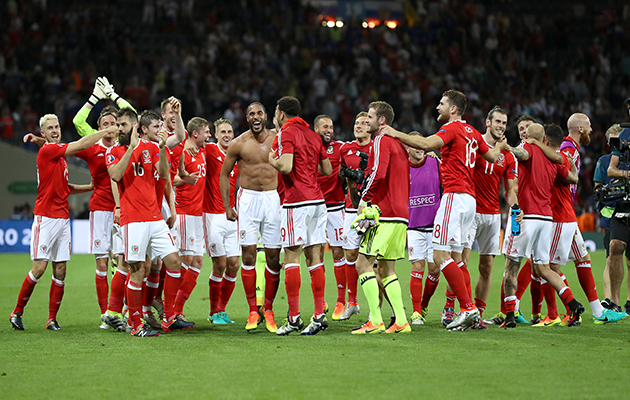 Wales players celebrate after their 3-0 win over Russia.