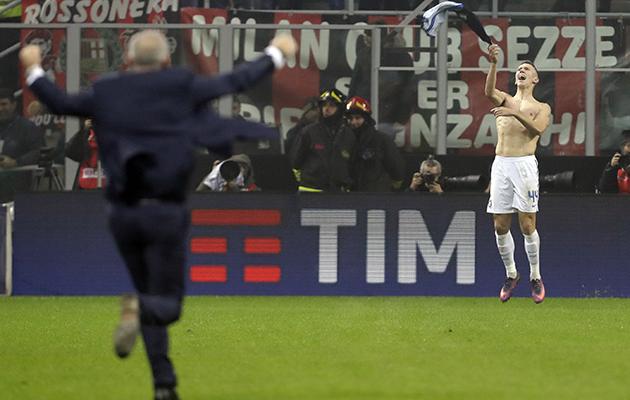 Ivan Perisic, right, celebrates his last gasp equaliser against Milan, as coach Stefano Pioli runs towards him.