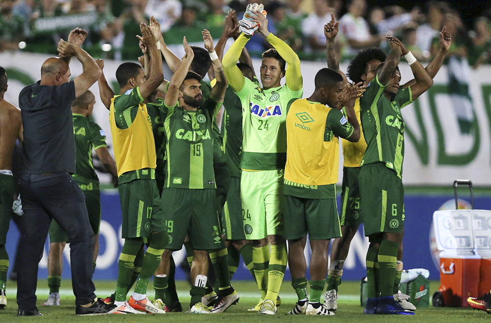 FILE PHOTO - Players of Chapecoense celebrate after their match against San Lorenzo at the Arena Conda stadium in Chapeco, Brazil, November 23, 2016. An aircraft with 81 people aboard, including Brazilian football team Chapecoense, crashed in central Colombia, the country's civil aviation association said on its website on November 29, 2016. REUTERS/Paulo Whitaker/File Photo Picture Supplied by Action Images
