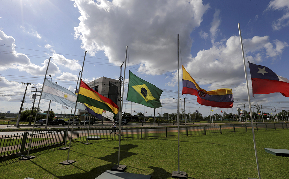 The flags of Brazil and the member countries of the South American Soccer Confederation (CONMEBOL) fly at half staff, paying tribute to members of Chapecoense soccer team in a plane crash in Colombia, in front of the headquarters in Luque,Paraguay November 29, 2016. REUTERS/Jorge Adorno  Picture Supplied by Action Images