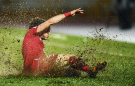 MALAYSIA...Omar Midani of Syria slides on the muddy pitch during a World Cup qualifier against Iran that was played at the Tuanku Abdul Rahman Stadium in Seremban for security reasons