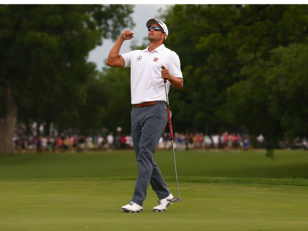 Adam Scott celebrates a birdie putt on the third playoff hole to defeat Jason Dufne in