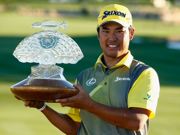 Hideki Matsuyama poses with the trophy having won the Waste Management Phoenix Open at TPC Scottsdale on February 7, 2016. Credit: Getty Images