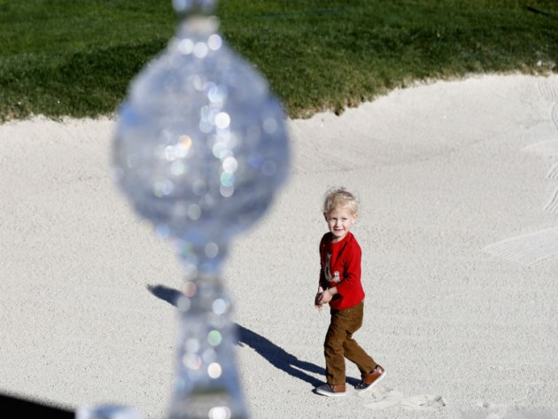 Locklyn Taylor, son of Vaughn Taylor, celebrates after his father Pebble Beach