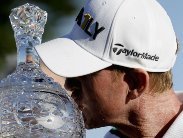 Vaughn Taylor poses with the trophy after winning the AT&T Pebble Beach National Pro-Am