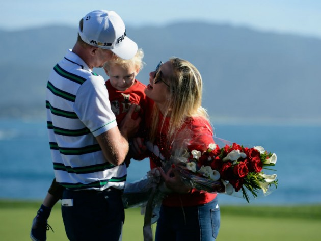 Vaughn Taylor celebrates with wife Leot and son Locklyn after winning at Pebble Beach