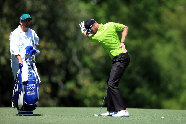 Chris Wood and caddie Mark Crane work out what to do with Wood's next shot. (Photo by David Cannon/Getty Images)