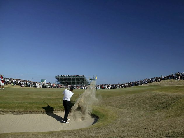 Thomas Bjorn of Denmark plays his second shot and first attempt to get out of the bunker on the 16th green during the final round of the Open Championship at the Royal St. George's. Credit: Getty Images Open golf chokes