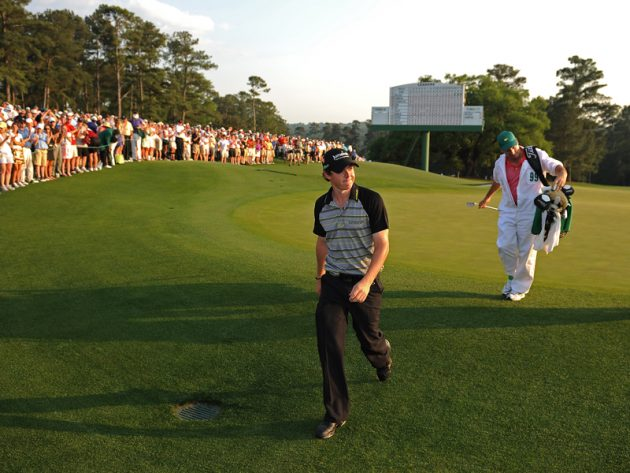 Rory McIlroy walks off the 18th