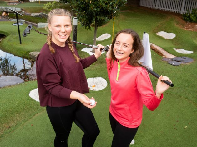 Girls celebrate playing golf during the Solheim Cup