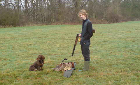 A young shot and his dog on a pheasant shoot.