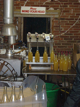Bottling the apple juice in the factory.