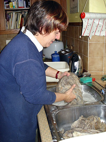 Val washing some wool