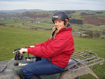 Lucy on a quad bike.
