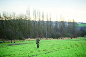 people shooting in countryside