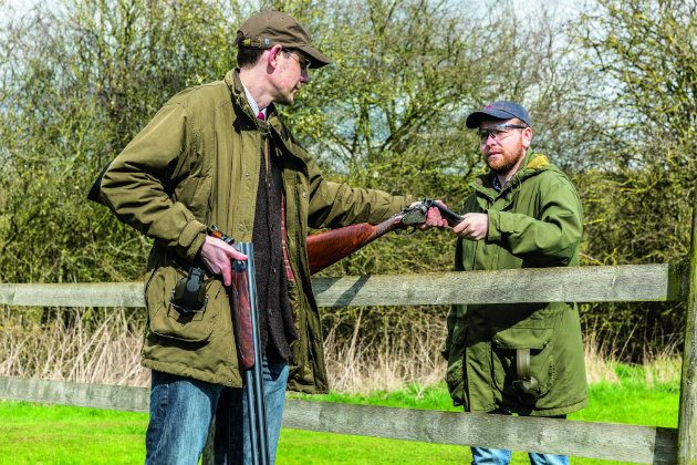 men with shotguns