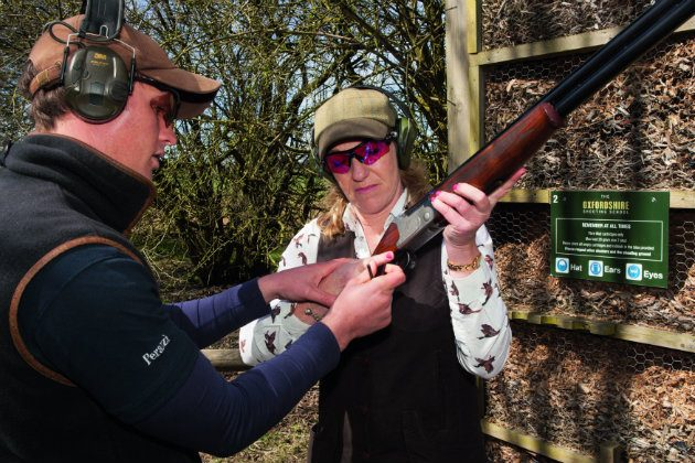 woman having shooting lesson