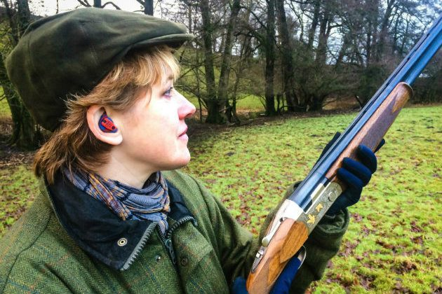 woman wearing shooting ear protection
